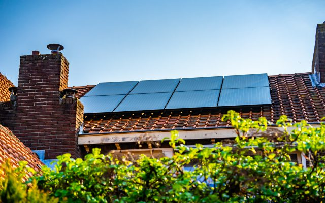 Waalwijk, Noord Brabant, Netherlands - Solar panels on the roof of a house for green power and a better environment.